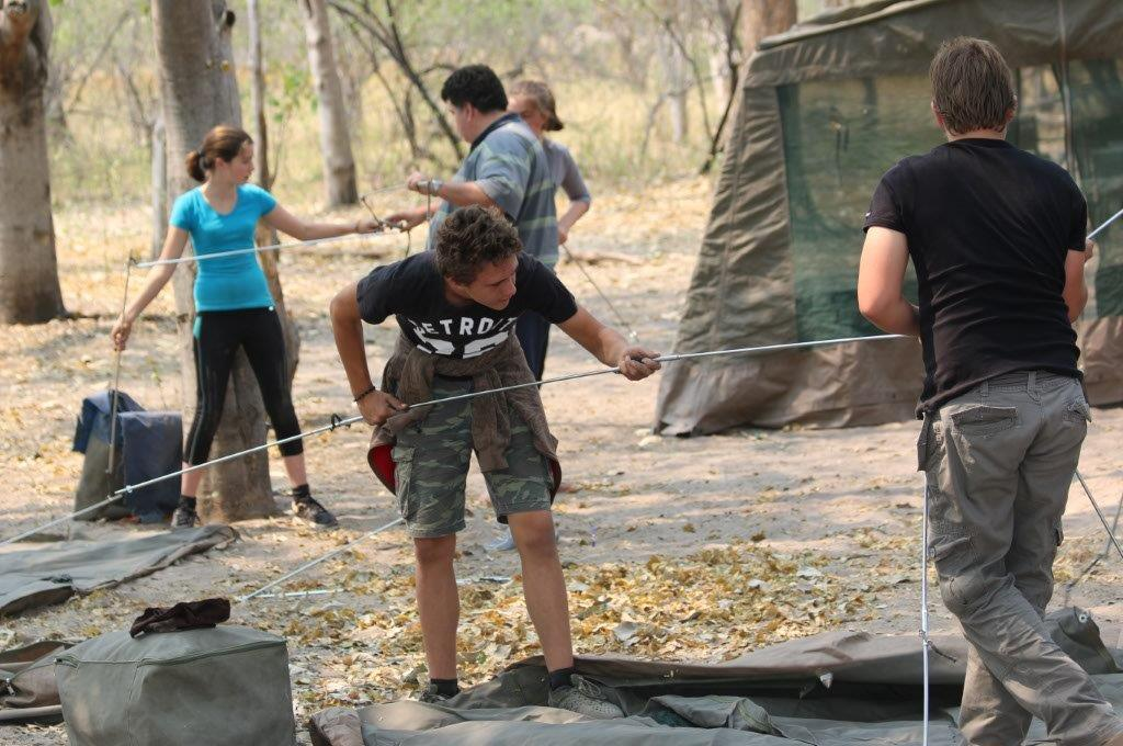 Erecting tents on an Adventurer mobile safari